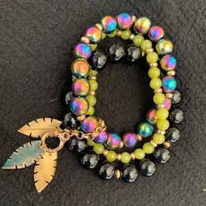 Trio of beaded stretch bracelets with leaf charms